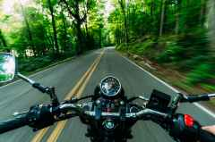 motor bike running close up photography